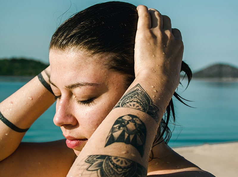 Summertime Skincare Tips for Your Tattoos | Newport Tattoo Removal